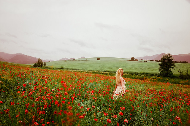 Woman in red flower field
